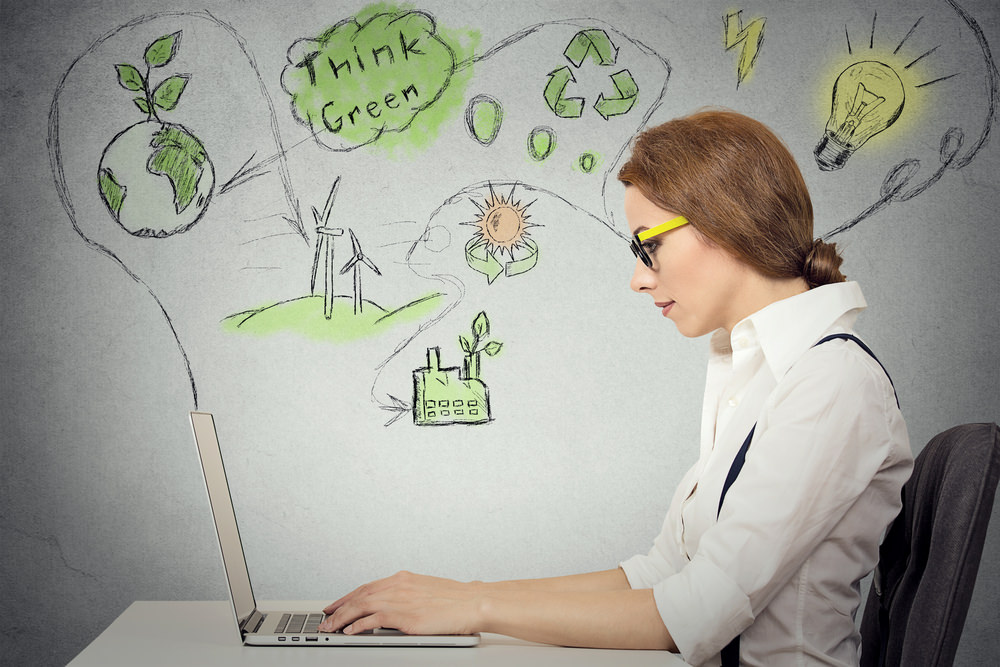 usiness Woman On Computer Thinking Green