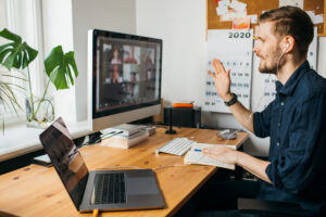 Man on a video call Top remote working digital tools to get your business on track
