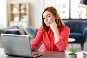 Thoughtful woman at her laptop Top remote working digital tools to get your business on track