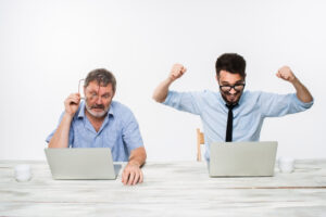 Two male workers at their laptops Top remote working digital tools to get your business on track